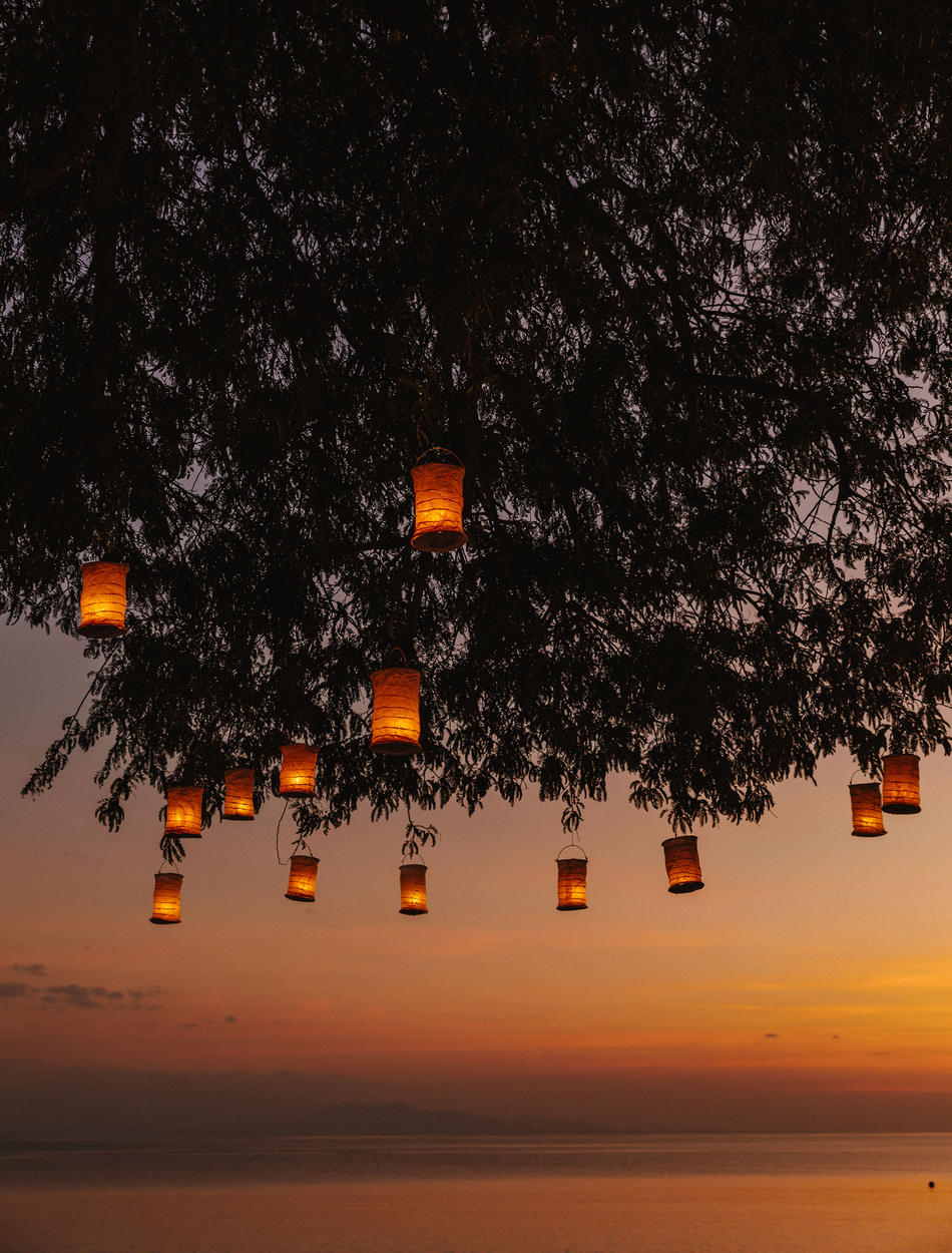 Amanwana - Sunset, Candles on tree
